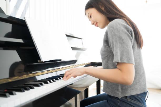 Portrait Asian woman playing  playing piano